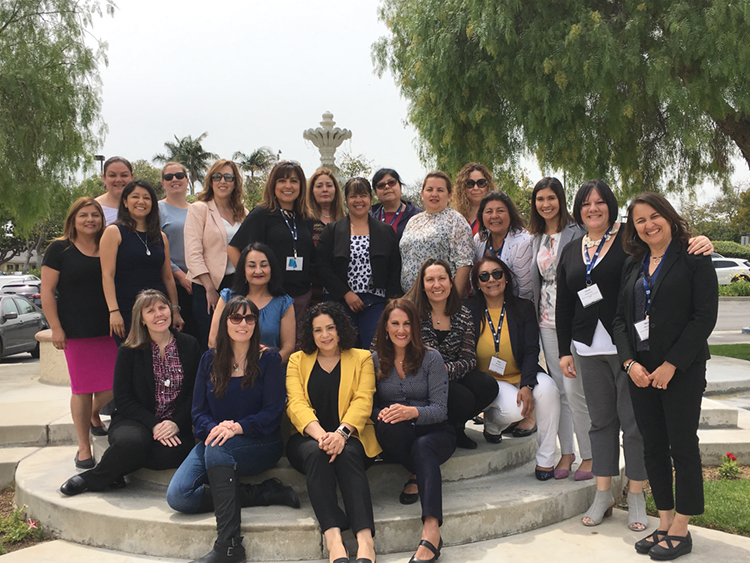 Attendees pose for a photo outside the Almansor Court venue in Alhambra, which played host to the Sisterhood Leadership Symposium on May 18.