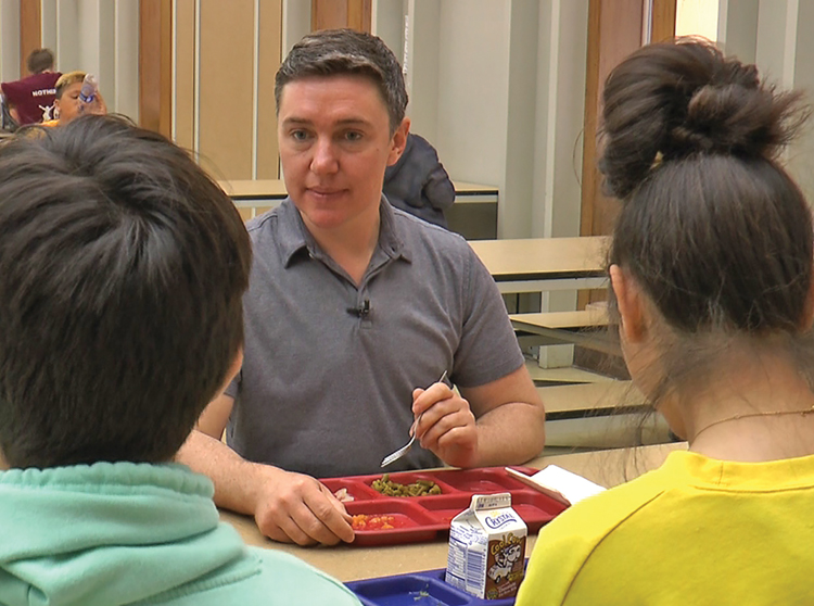 "Superintendent-Principal Lark Doolan eats lunch with students in the cafeteria. He says transitioning to living as a man was ""much smoother"" than anticipated thanks to his students and staff."