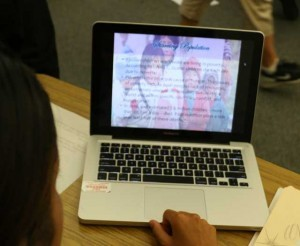 Student works on PowerPoint presentation