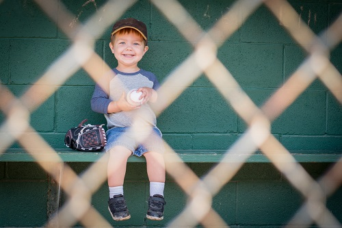 Little Kid in Dugout
