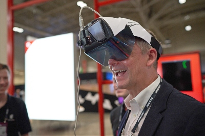 A man smiling and wearing a VR headset