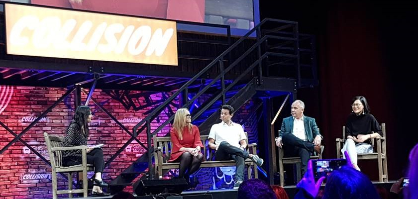 Speakers sitting on a stage at the collision conference