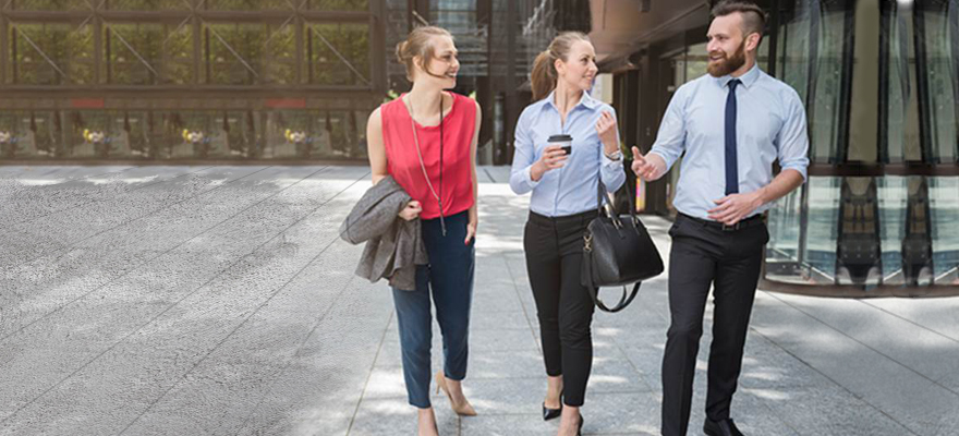 coworkers walking outside of office building