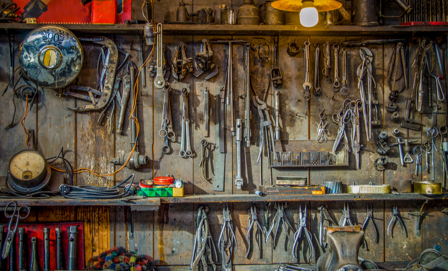 Vintage tools hanging in a shed meant for repair and renovation