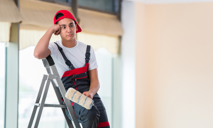 Picture of a frustrated painter on a ladder