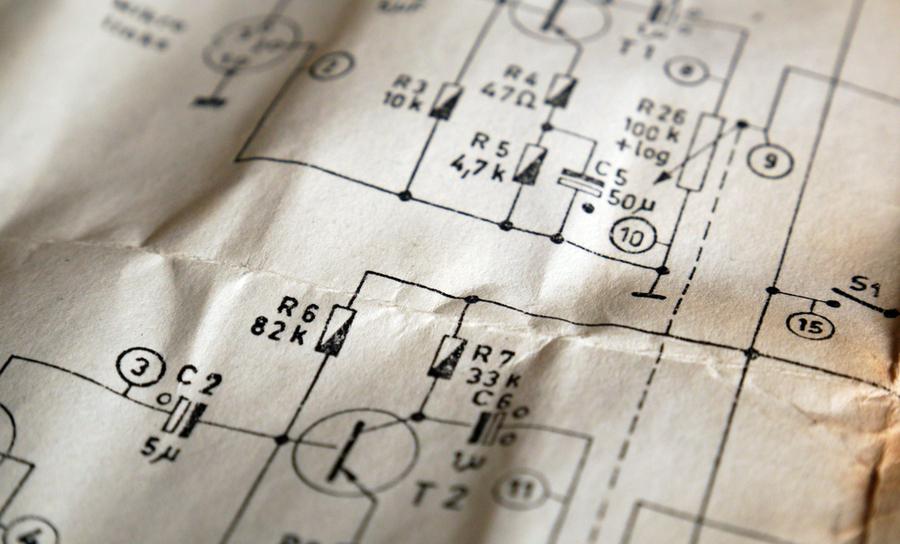 Schematic diagram symbols on crumpled circuit board schematic