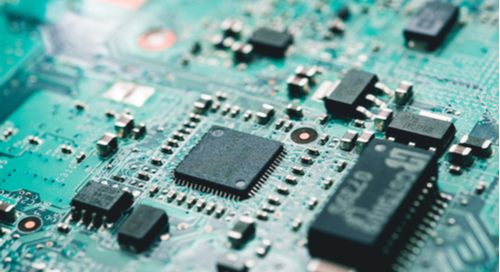 Green printed circuit board with microcontrollers and pins