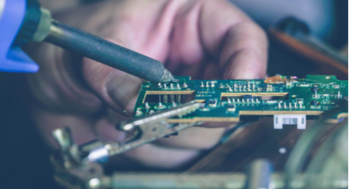 An engineer who knows why impedance matching is important tests a circuit board