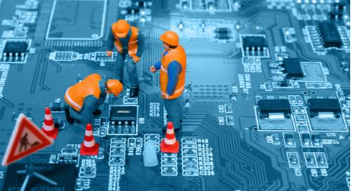 Repair crew fixes circuit board