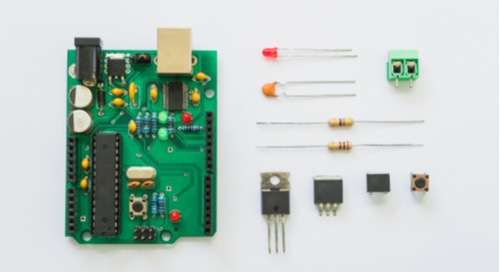 Components and circuit board on a white background