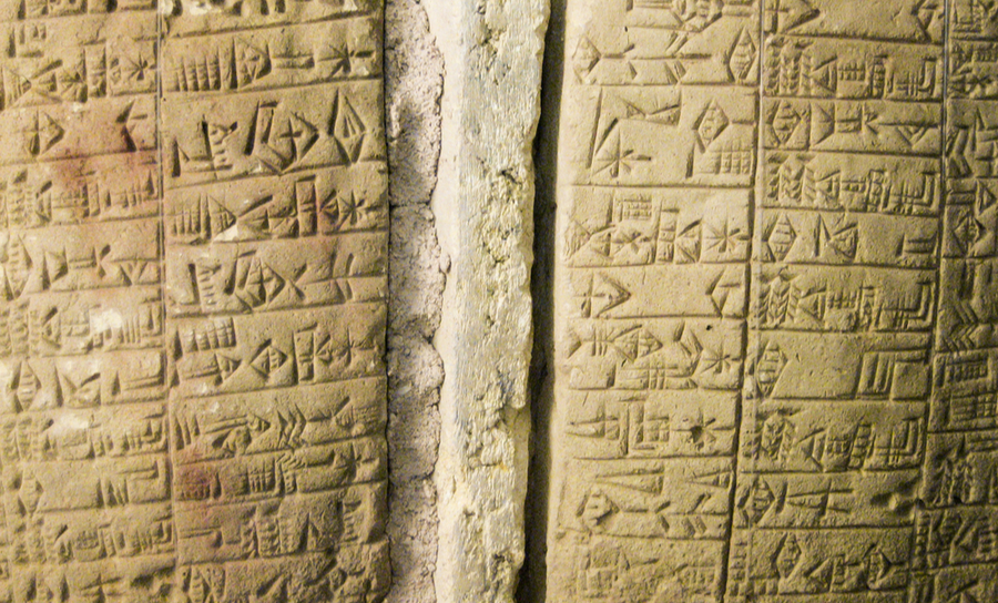 Two clay tablets with ancient scrypt on them
