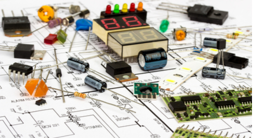 Group of electronic components splayed on a schematic