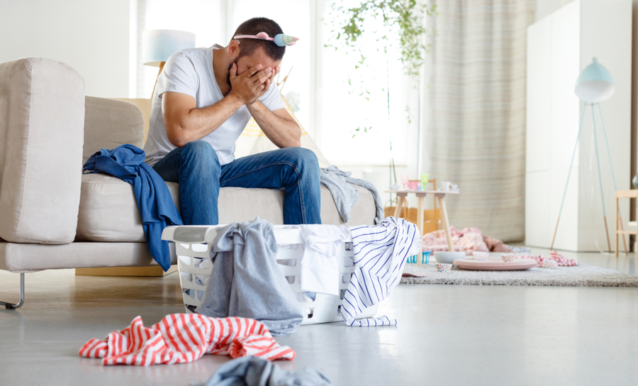 Young father overwhelmed with chores and has no idea what he is doing