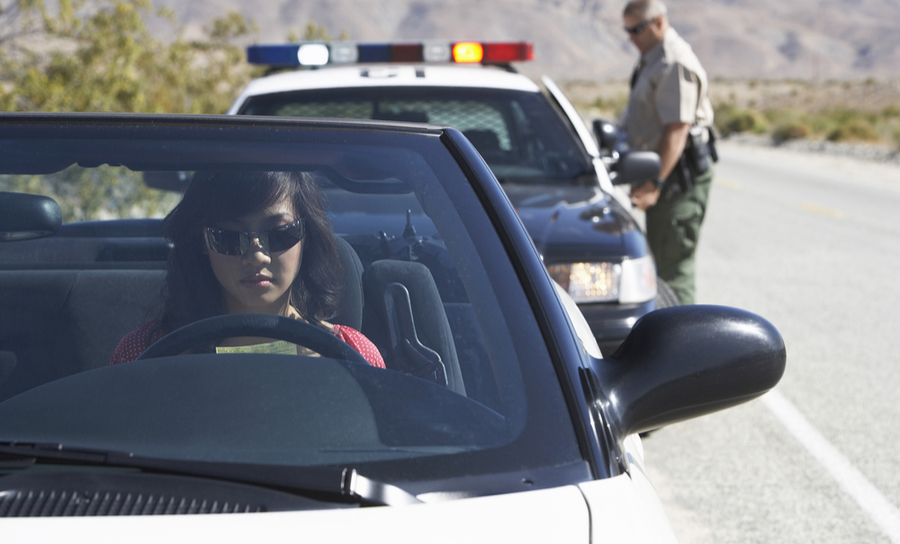 Picture of woman getting a traffic ticket for unsafe driving speeds