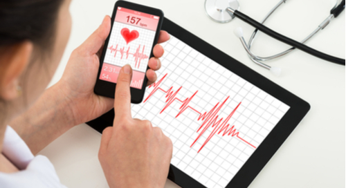Heart rate monitor on a smartphone connected to a tablet showing pulsation