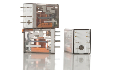 Relays stacked atop each other within see-through enclosures