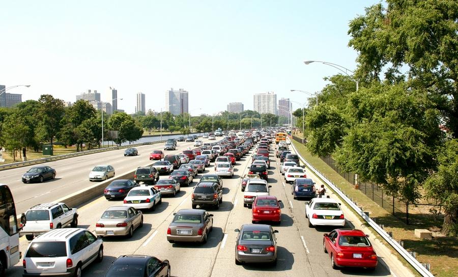 Cars stuck in traffic heading toward a city