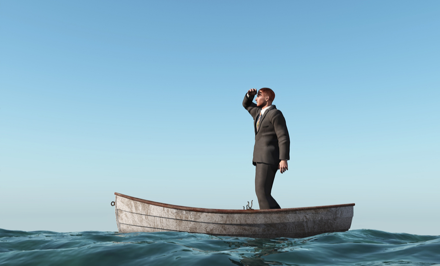 Picture of man lost at sea in a boat looking for a return path back home