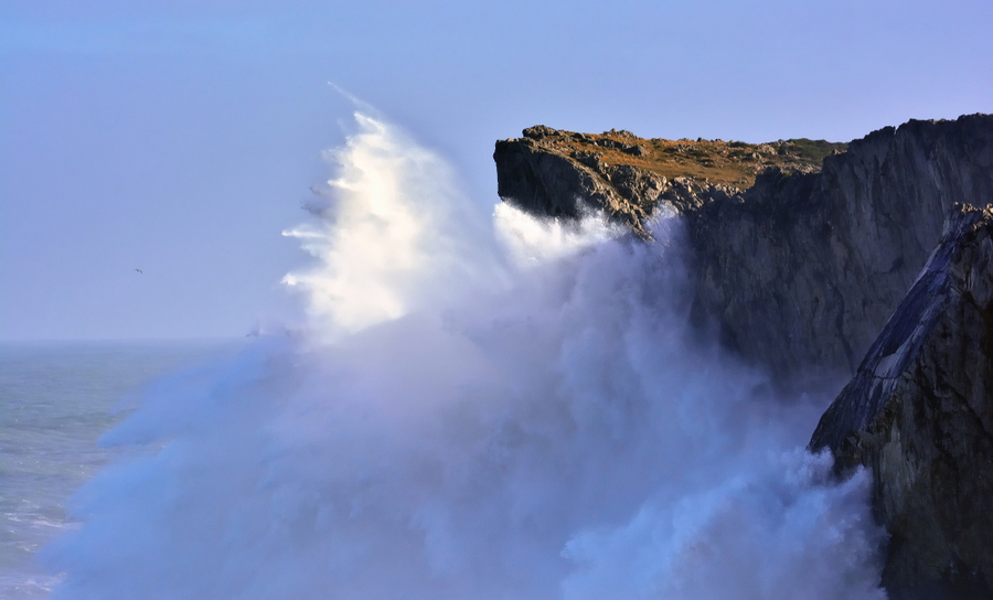 Waves crashing against a cliff