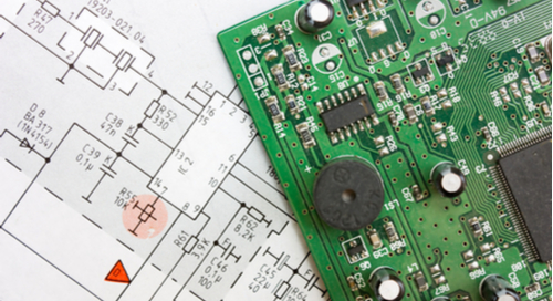 Green circuit board overlaying a schematic showing component diagrams and trace routing