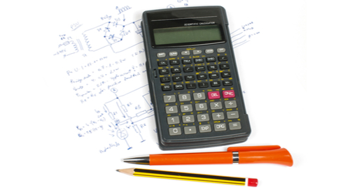 Calculator, pen, and pencil on top of mathematical and circuit equations