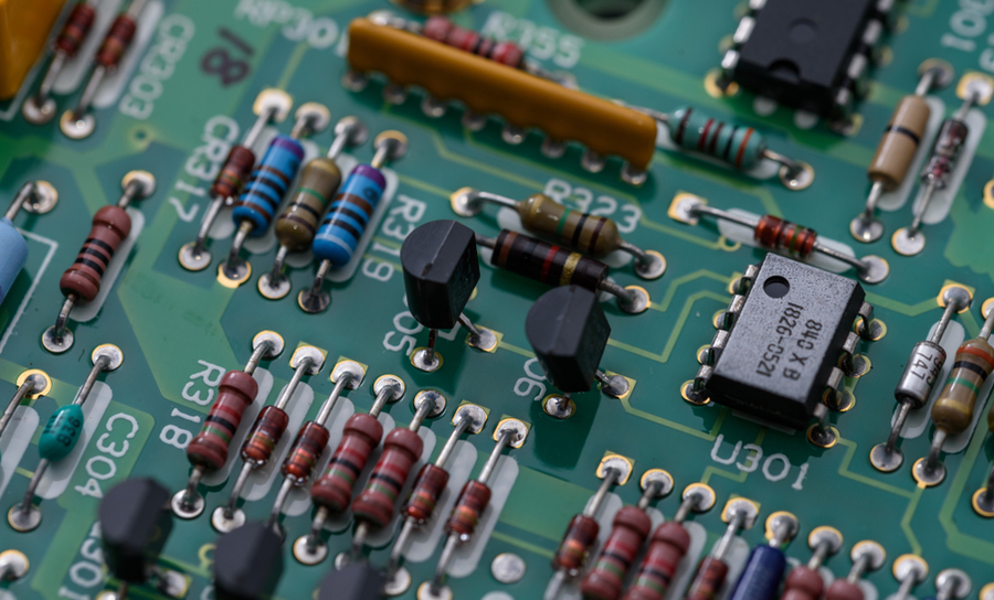 Passive and active components on a green PCB