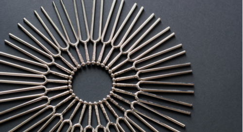 Tuning forks laid out in a circle