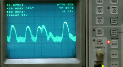 Graphic image of a frequency waveform on an old monitor