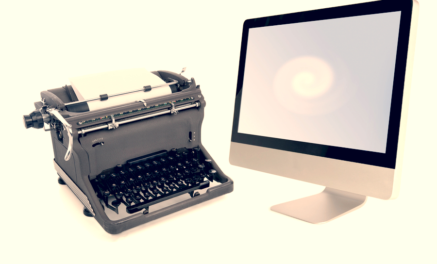 Image of an old typewriter along with a modern flat screen monitor in EDA tools