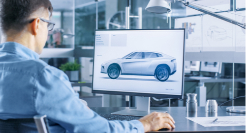 Man using computer to analyze an automotive design