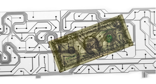 The outline of a circuit laid over a dollar bill