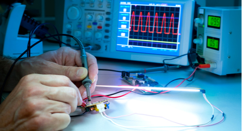 Hands at work testing a circuit