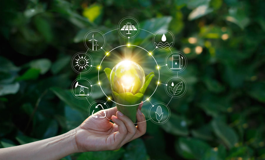 Light bulb and electronics surrounded by a green environment