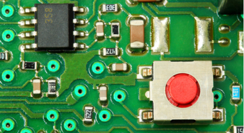 Green printed circuit board with components on it