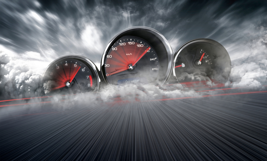 Speedometers on a road with clouds around them