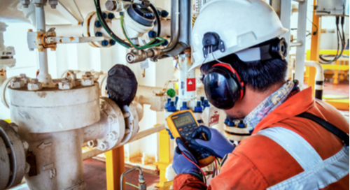 Engineer calibrating and taking measurements in an industrial laboratory setting