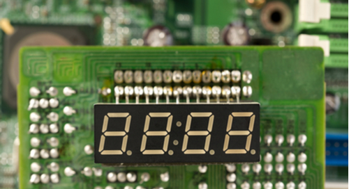 Picture of a clock placed on a circuit board