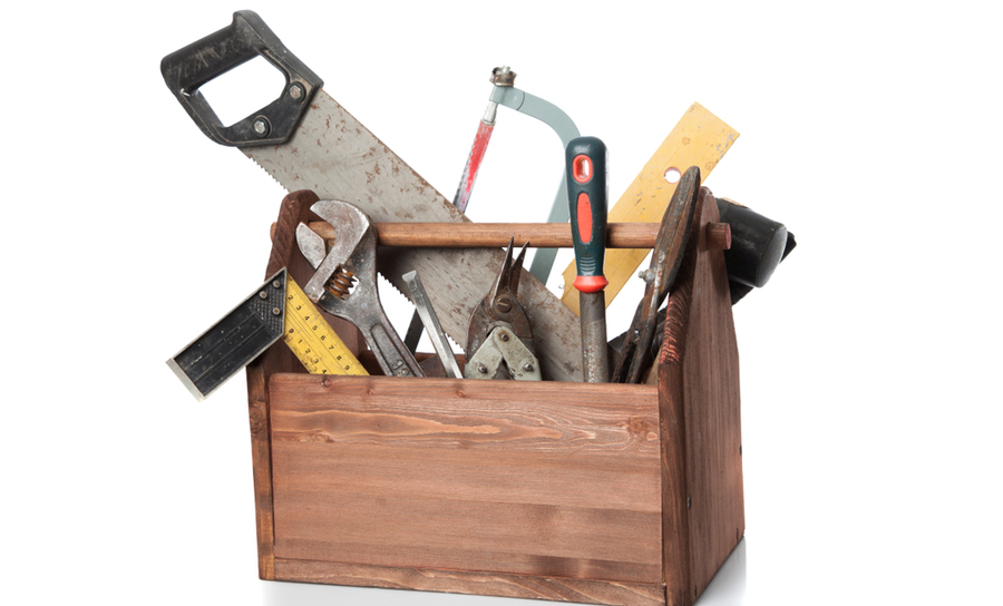 Picture of an old carpenter's toolbox filled with tools