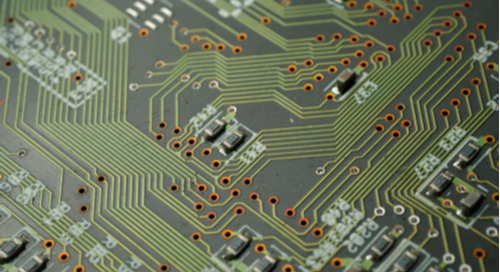 Microvias and SMT components across a green printed circuit board