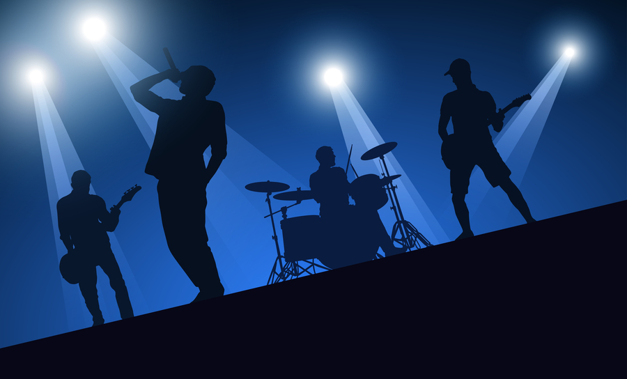 Silhouette of a rock and roll band on stage