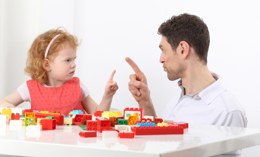 Picture of a defiant child arguing with her father