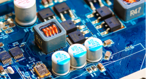 Picture of PCB components placed on a blue circuit board