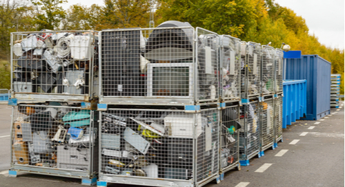 Netted bins full of electronic trash, discarded computers and monitors