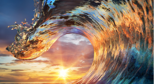 A wave in the sunset, reflecting light like signal reflection