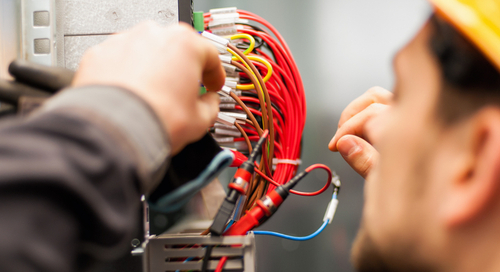 Mechanical engineer working or technician on wiring