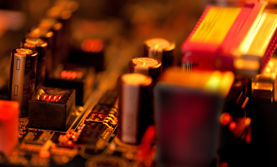 An overheated transistor on a printed circuit board