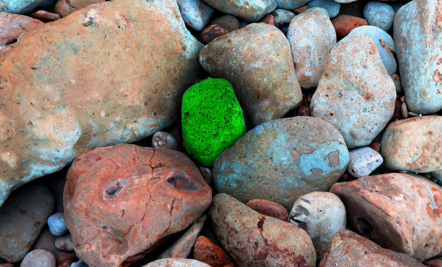 Picture of a bright green rock, is it kryptonite and will we be vulnerable to it?
