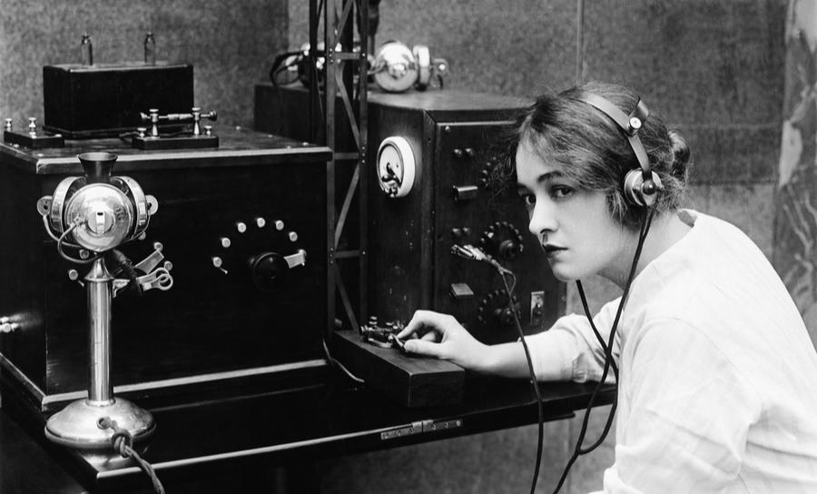 Woman sending Morse Code