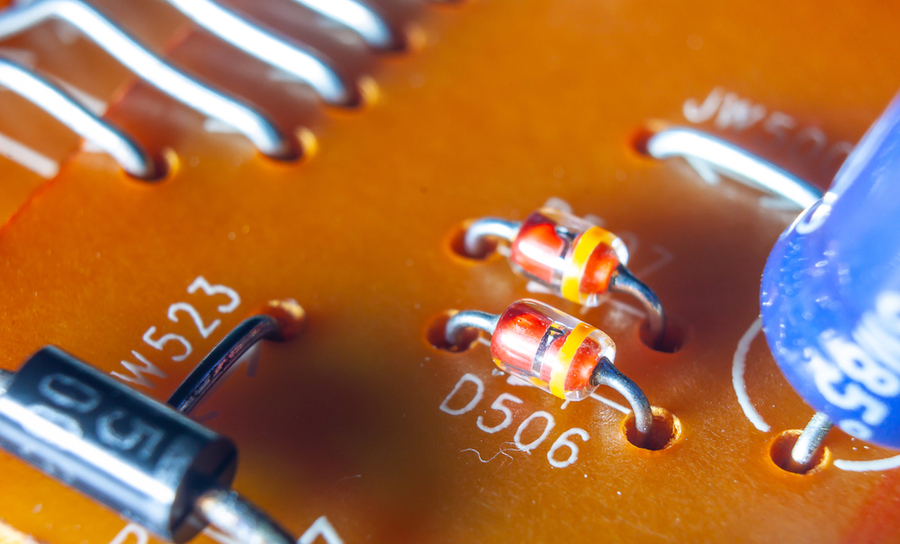 Two diodes placed on an orange circuit board