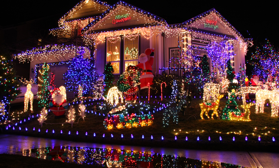 Picture of a house with a lot of Christmas lights displayed